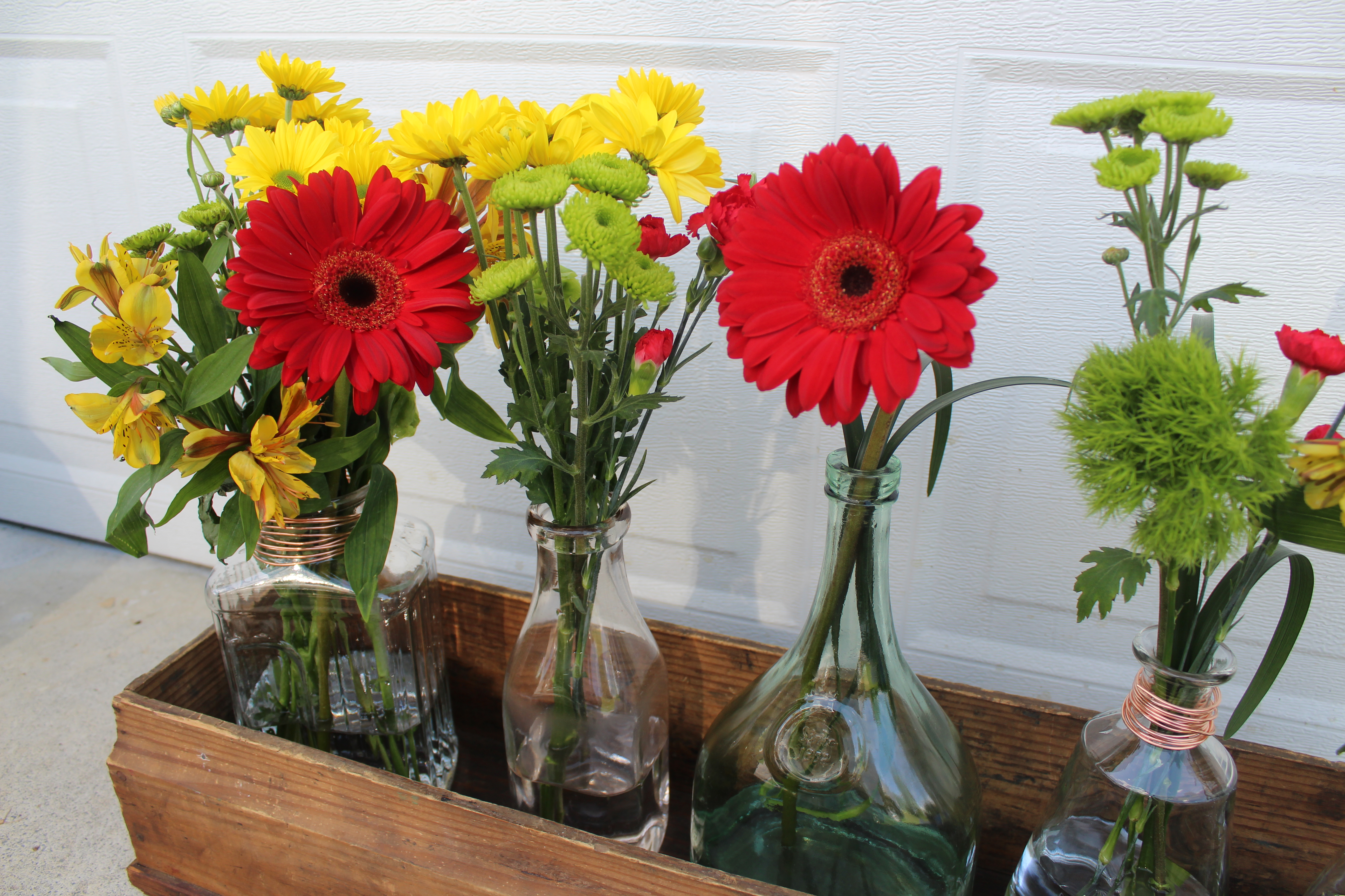 Easy Farmhouse Decor: Glass Bottle Flower Arrangement